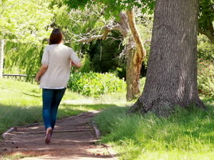 stock-footage-woman-walking-in-a-park-alone